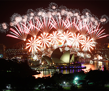Fireworks explode over Sydney Harbour Bridge and Opera House during a pyrotechnic show to celebrate the new Year